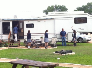 Students analyzing the RV that they will design an awning for